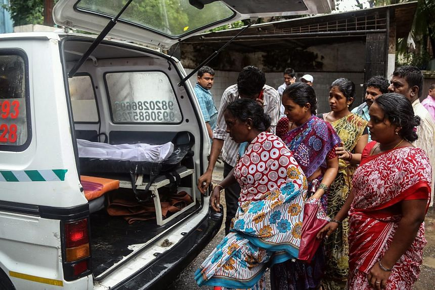 Relatives of people who died of consumption of poisonous liquor claim the bodies at Bhagwati Municipal General Hospital in Mumbai, India on June 19, 2015.