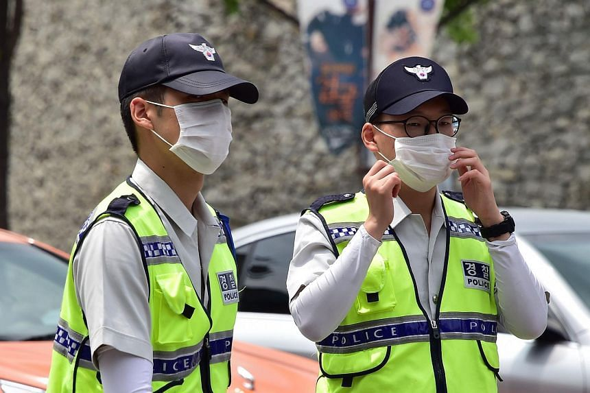 South Korean policemen with face masks in downtown Seoul.