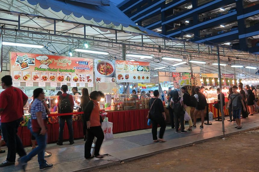 Customers browsing the stalls at a Ramadan bazaar located next to Woodlands MRT station.