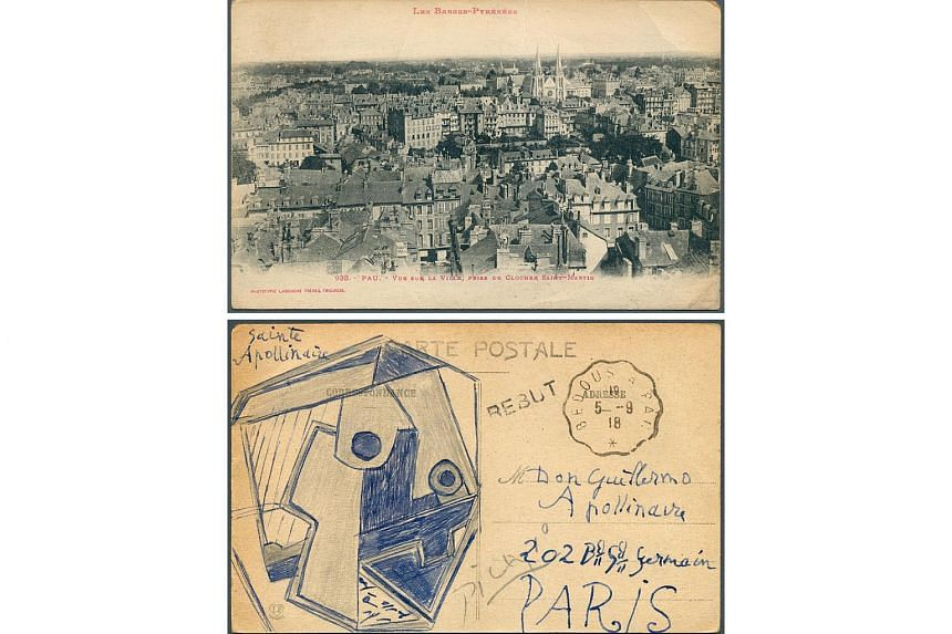 The combo of two undated recent handout pictures shows a picture postcard, displaying on its recto a view of Pau, France, and on its verso a drawing signed Pablo Picasso.