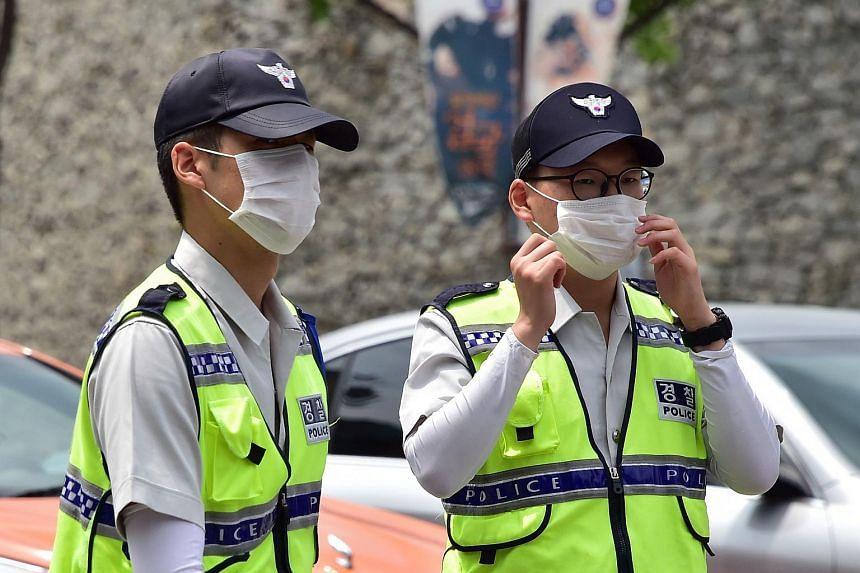 South Korean policemen wearing face masks.