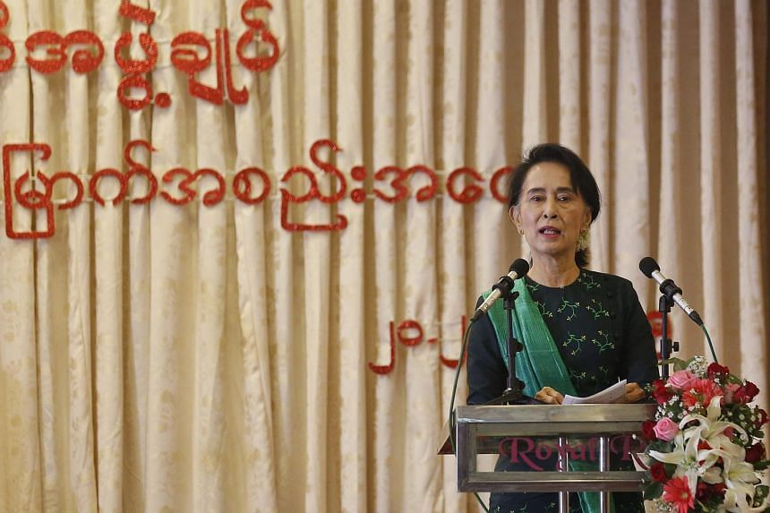 Myanmar opposition leader Aung San Suu Kyi delivers a speech at her National League for Democracy party central committee meeting in Yangon, Myanmar.