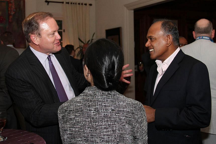 Minister K Shanmugam attending a reception for a bipartisan group of Congressional Chiefs of Staff hosted by Ambassador in Washington Ashok Mirpuri, 18 June 2015