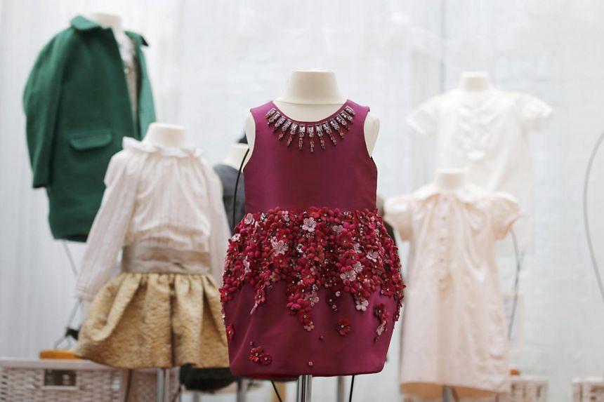 A pink flower-and jewel-embellished Mischka Aoki dress