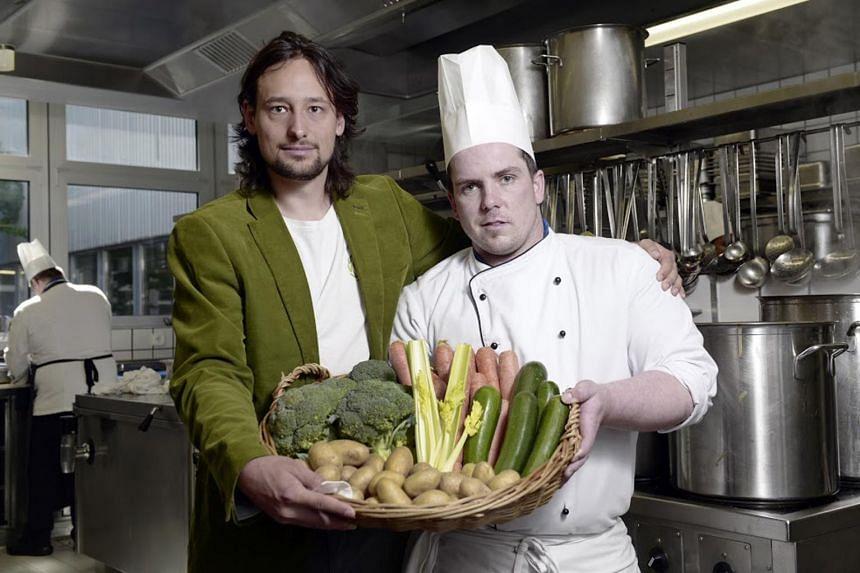 Eaternity CEO Manuel Klarmann and head chef Daniel Mietusch at Villaggio, a self-service restaurant at Technopark Zurich. Mr Mietusch plans his menu with a carbon emission calculator designed by Eaternity.
