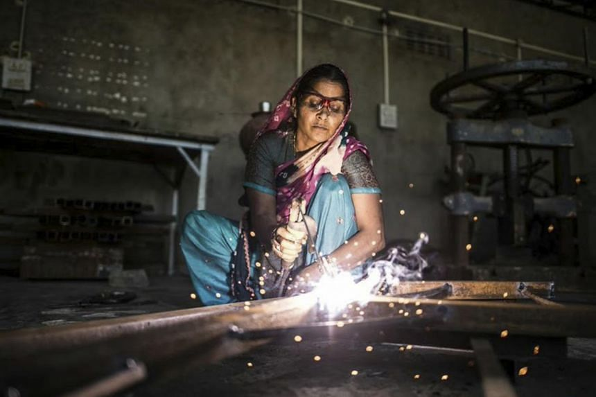 At Barefoot College in Tilonia, India, rural women learn to make solar panels to provide their villages with power.
