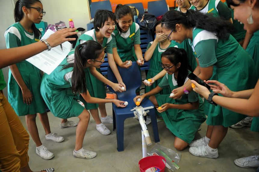 Above: Students from Tanjong Katong Girls School trying out a prototype of an aqueduct at a day camp organised by Girls2Pioneers.