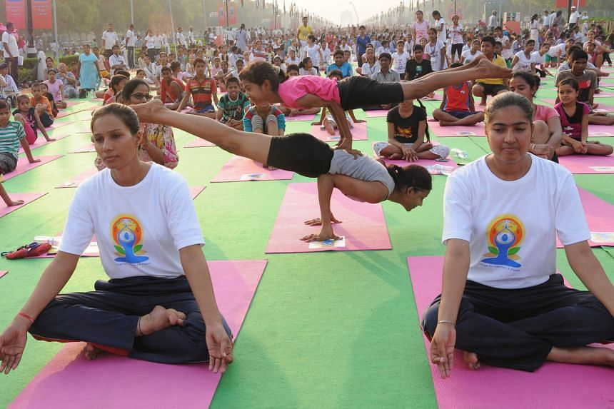 Enthusiasts rehearsing ahead of International Yoga Day at Rajpath in New Delhi yesterday. Some 35,000 people will take part in the 35-minute mass outdoor yoga session in the capital tomorrow.