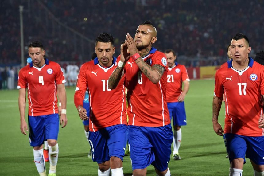 Chile's midfielder Arturo Vidal (centre) acknowledges the crowd at the end of the first half of the 2015 Copa America football championship match against Bolivia.