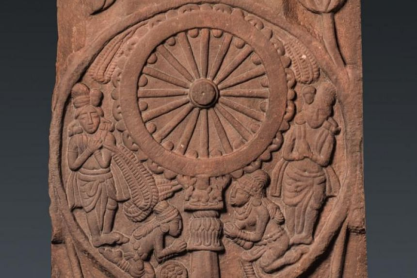 Worship of the Wheel of the Law.