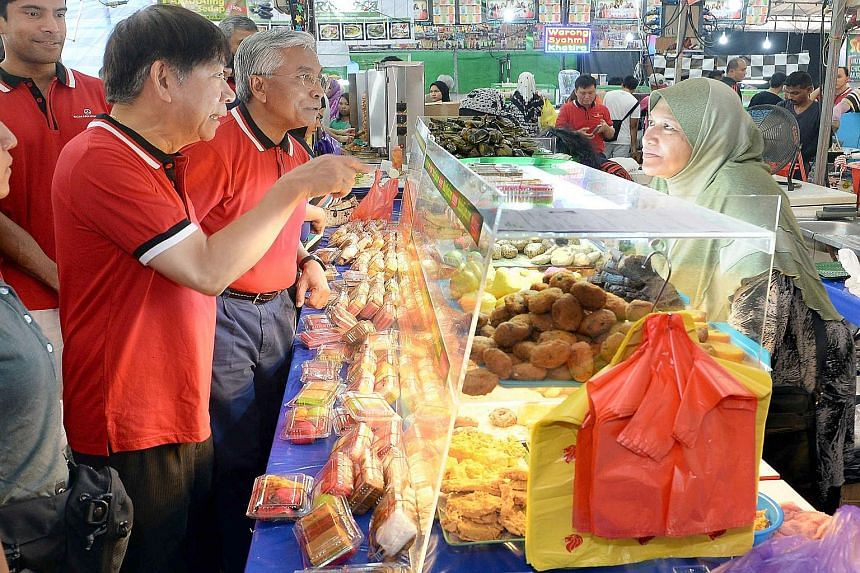 National Development Minister Khaw Boon Wan officially opened Bazar Raya Utara 2015. He was among 50 non-Muslims who fasted yesterday.