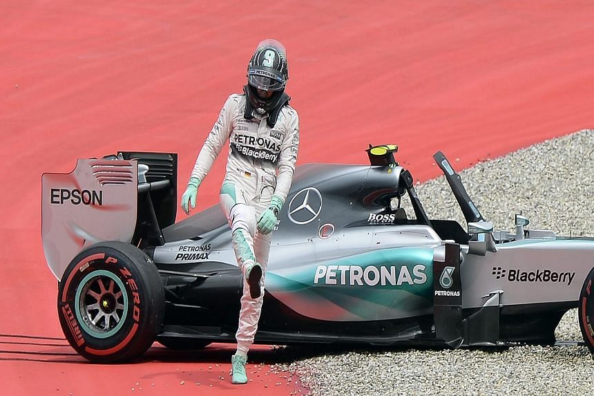 A frustrated Nico Rosberg faces a long walk back to the pits after his car runs off the track at the final corner in his final attempt to grab pole. His Mercedes team-mate Lewis Hamilton will start in pole position today - the first Briton to do so i