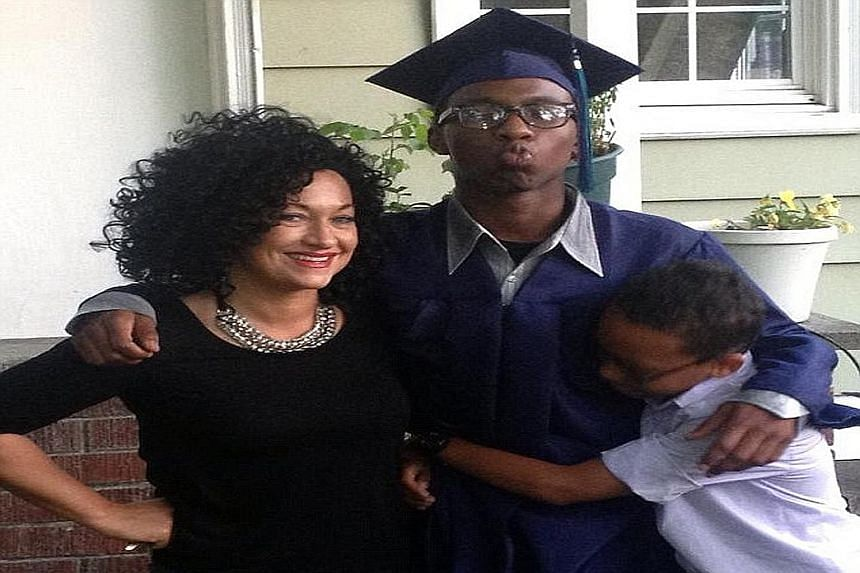 """Ms Rachel Dolezal's blog posts and interviews often make reference to her """"black sons"""". But her mother says one of the boys is Izaiah, one of four black Americans Ms Dolezal's parents adopted in the 1990s."""