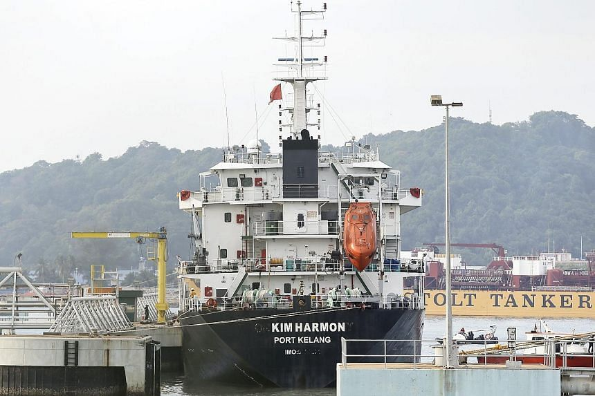 MT Orkim Harmony, which was hijacked last week, arriving in Kuantan Port yesterday with 21 crew members. Another crew member, a cook, was taken to hospital earlier to be treated for a gunshot wound in the thigh.