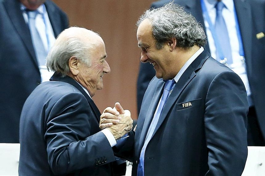 Uefa president Michel Platini (right) congratulating Fifa president Sepp Blatter after his re-election, having campaigned against him. Their feud is set to worsen.