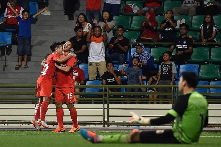 Shahdan Sulaiman (No. 15) celebrating with Sahil Suhaimi after scoring the LionsXII's third goal, upon his return from a horrific broken ankle at last year's AFF Suzuki Cup.
