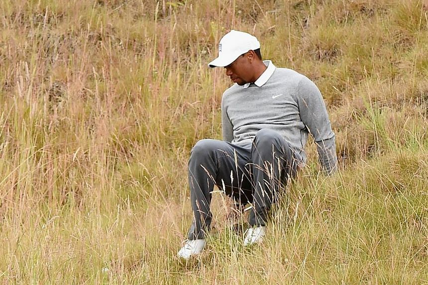 Tiger Woods is not only in poor form but also loses his footing in the rough during the US Open second round.
