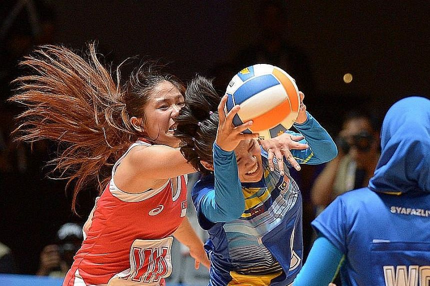 Singapore's Kimberly Lim trying to stop Malaysia's Nurul Adha Abu Bakar during the SEA Games. Kaplan has surprised her with a $32,000 scholarship.