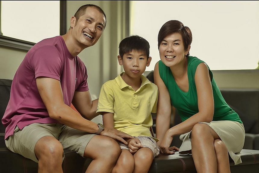 """Mr Lawrence Ng, his wife Jen, and their son Kai Herng. Mr Ng's life revolves around being Kai Herng's father, coach, cheerleader and """"only friend""""."""