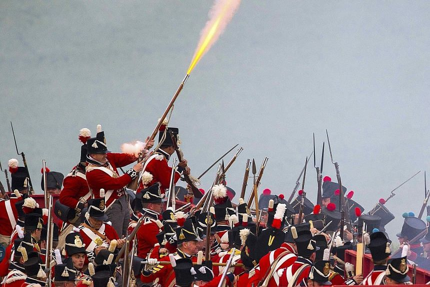 """Performers re-enacting """"The French Attack"""" to mark the 200th anniversary of the Battle of Waterloo, in Waterloo, Belgium, last Friday. Allied forces defeated Napoleon's army in 1815, changing the course of history in Europe."""