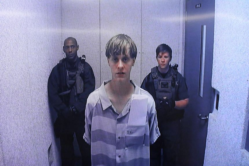 Suspect Dylann Roof appears via video link at a bond hearing in court in North Charleston, South Carolina. The judge set Roof's bail at US$1 million.