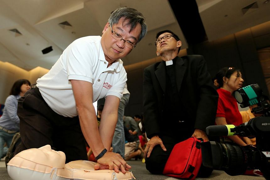 Health Minister Gam Kim Yong (left) and Reverend Pastor Derrick Lau (right) at Sunday's CPR training session.