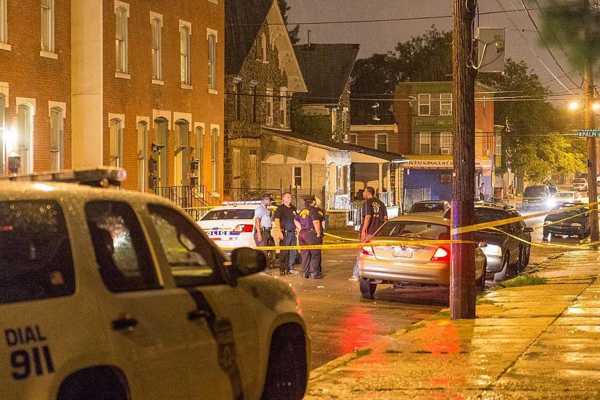 Police investigate the scene of a shooting along Ogden Street in Philadelphia, US.
