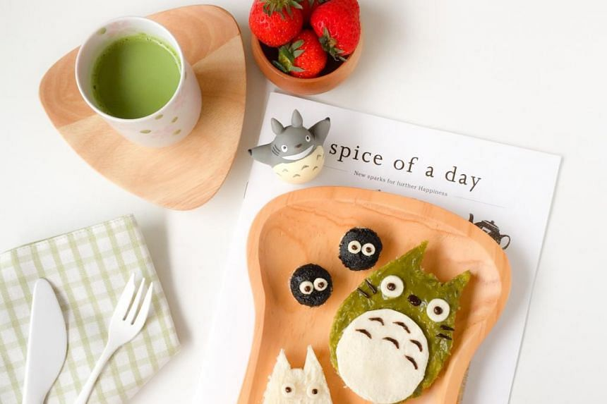 Ms Shirley Wong gets up at 5am to put a creative touch to her lunch, such as cutting seaweed to make the image of a geisha on her rice and using different food items to create the Totoro meal (above).