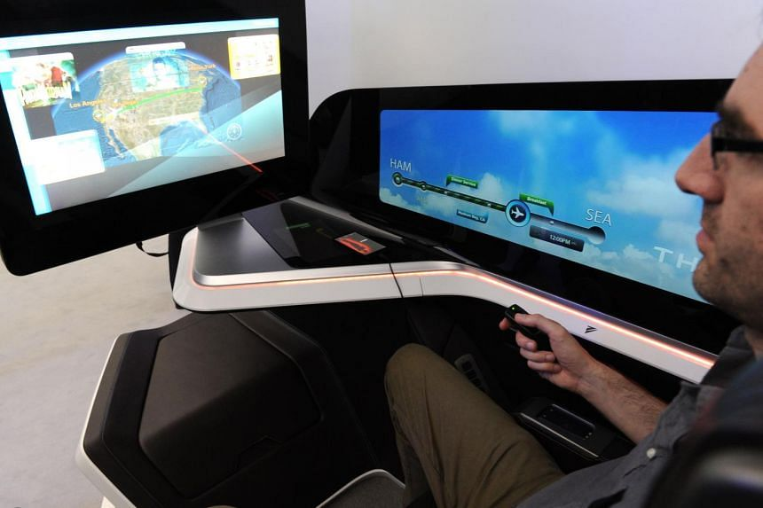 A visitor to the Paris Air Show trying out French manufacturer Thales' prototype in-flight entertainment for the next generation of business-class seats, which includes iris-tracking to tell when passengers are looking away.