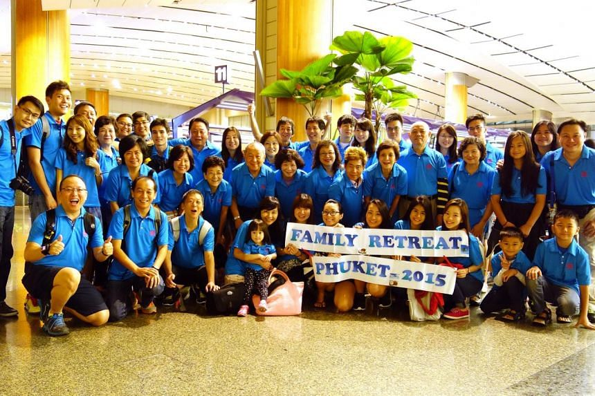 Forty-five relatives showed up for the third big family trip for the Teo family (above) this year. They went to Phuket island in Thailand and took part in activities such as tug-of-war.