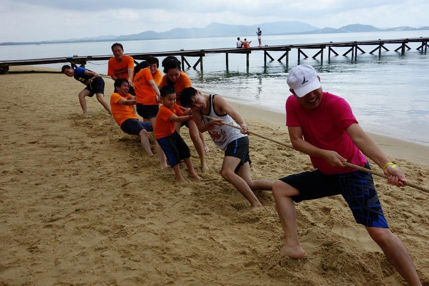 Forty-five relatives showed up for the third big family trip for the Teo family this year. They went to Phuket island in Thailand and took part in activities such as tug-of-war (above).