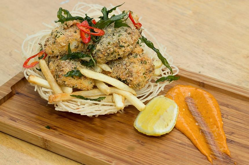 A dish that will be served during Singapore Restaurant Month is Timbre's Laksa Marinated Crispy Barramundi.