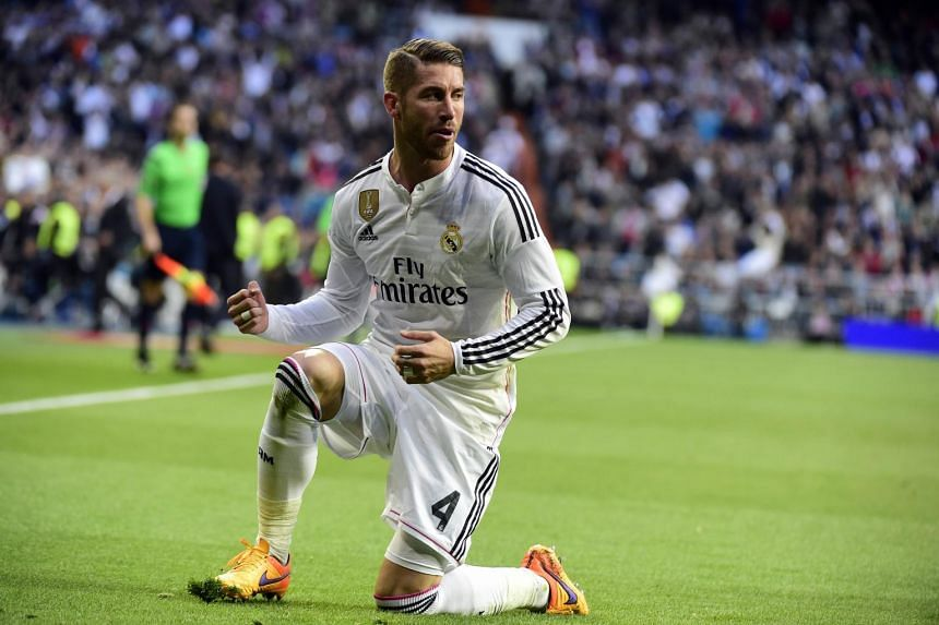 Real Madrid's defender Sergio Ramos celebrates after scoring during the Spanish league football match between Real Madrid CF and Malaga FC.