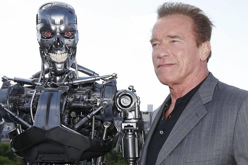 Arnold Schwarzenegger with the Terminator animatronics robot from Terminator Genisys, the latest film in the franchise.