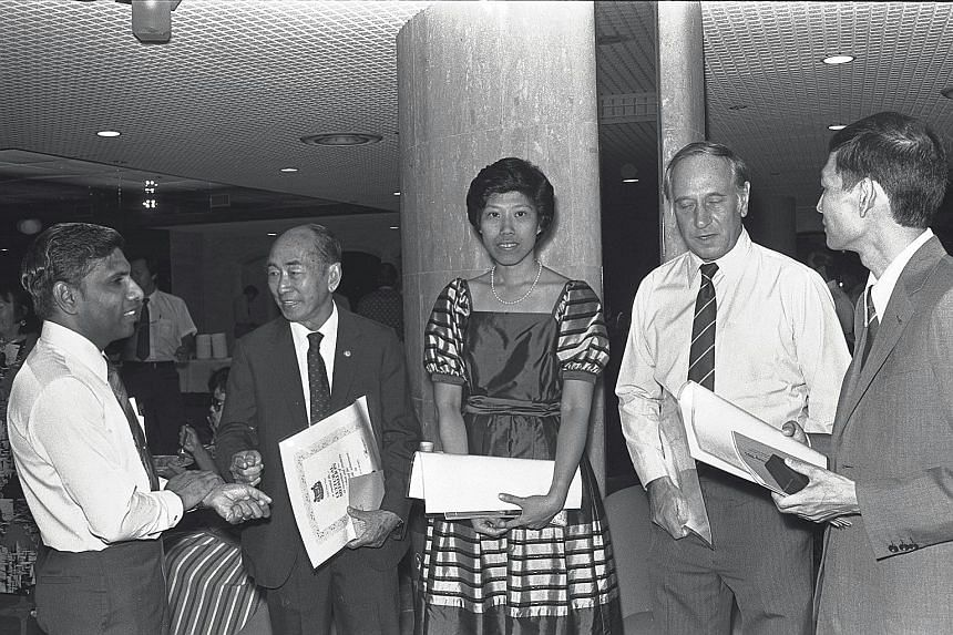 Goh (above) receiving the Cultural Medallion in 1984 with photographer Ang Chwee Chai and drama actor-director Christopher Allen, and conducting a rehearsal last month.