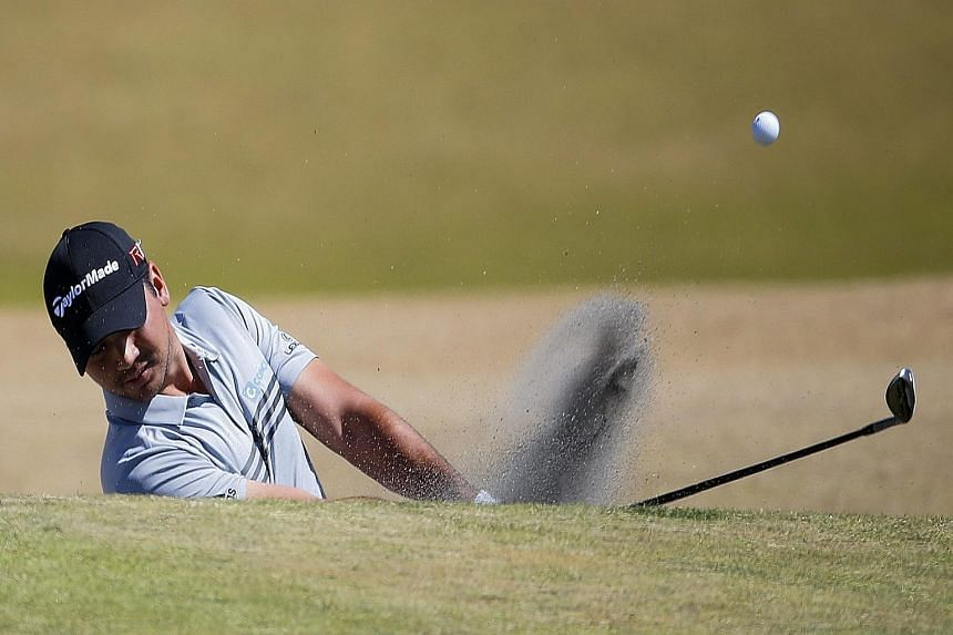 Jason Day being tended to by caddie Colin Swatton as he lay on the ninth green after collapsing from dizziness during the second round. There were doubts whether he could even play the next day.