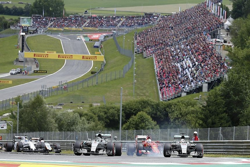 Mercedes' Nico Rosberg (front, left) leading the Austrian Grand Prix going into the second corner after overtaking pole sitter and team-mate Lewis Hamilton.