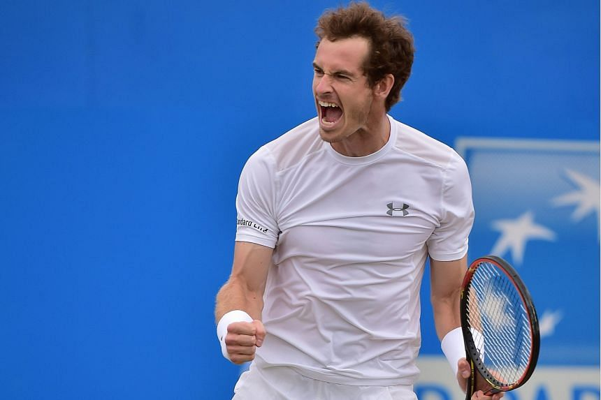 Britain's Andy Murray celebrates beating South Africa's Kevin Anderson for his fourth Queen's Club title in London.