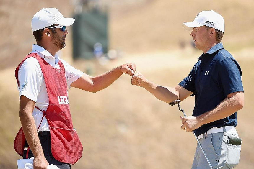 Golfer Jordan Spieth (right) with his caddie Michael Greller, who used to be a school teacher. The rest of Spieth's entourage is made up of ordinary folk such as his ninth-grade science-lab partner.