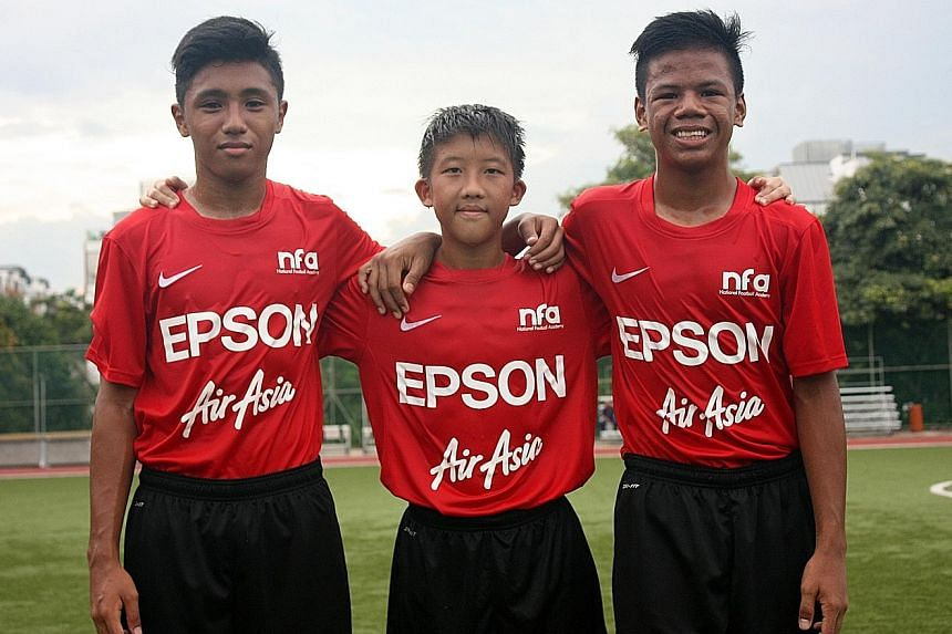 (From left) National Under-14 squad footballers Hamizan Hisham, Elijah Lim and Nur Adam Abdullah. Their stint comes under a three-year deal between the FAS and Epson, which sponsors Yamaga.