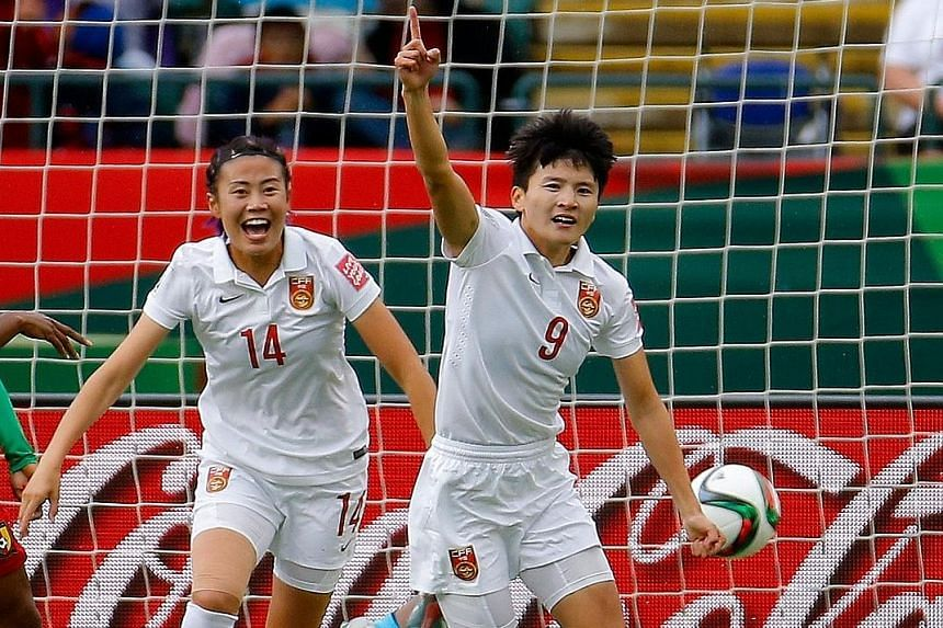 Striker Zhao Rong (left) is delighted after defender Wang Shanshan scores against Cameroon in their Women's World Cup game in Canada.