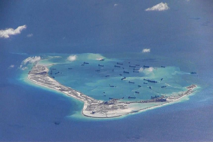 Chinese dredging vessels purportedly seen in the waters around Mischief Reef in the disputed Spratlys. Standing up more forcefully on the world stage for China's interests is one of the key pillars of Mr Xi's agenda. For its tiny and indefensible art