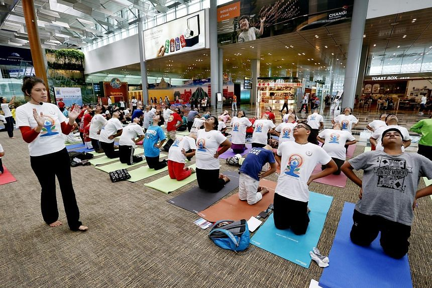 SINGAPORE: Yoga instructor Patricia Lorenz holding a session at Changi Airport yesterday. The sessions were conducted in 50 venues islandwide by yoga school Vyasa Yoga, which provided 70 teachers.