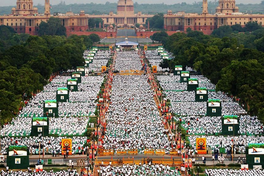 NEW DELHI: Thousands of participants performing yoga in Rajpath boulevard yesterday to mark the first International Day of Yoga.