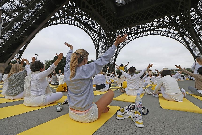 PARIS: Hundreds of participants attended a session under the Eiffel Tower in Paris. India was to be joined by yoga enthusiasts in 192 other countries for the event.
