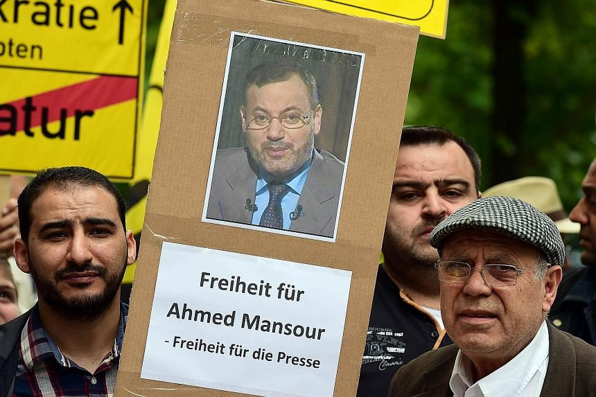 Protesters calling for the release of journalist Ahmed Mansour in Berlin's Tiergarten district, where he is being held.