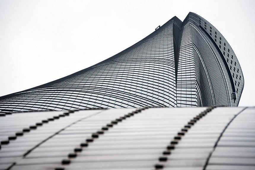 """An upward view of Shanghai Tower, the world's second-tallest building. The glass and steel tower has a softened triangular """"outer skin"""" twisted around a circular core, sending it spiralling 632m into the sky. It will open within the next three months"""