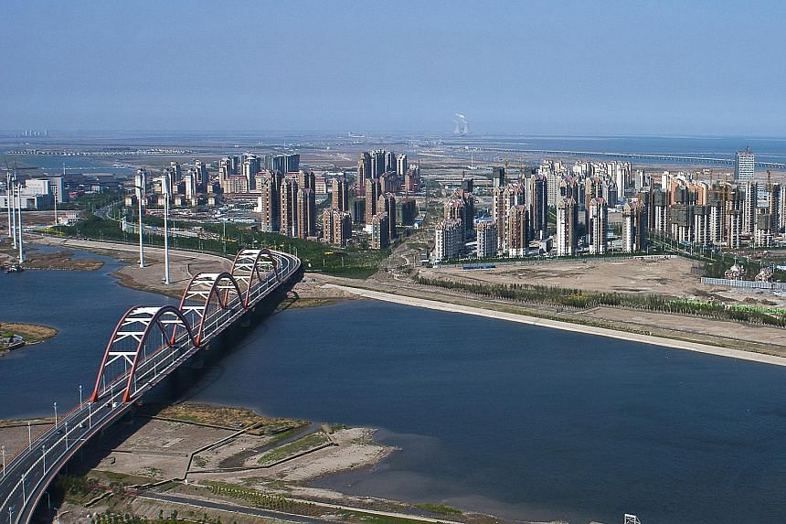 The Tianjin Eco-city seen in 2008 and in 2012 (above) after development.