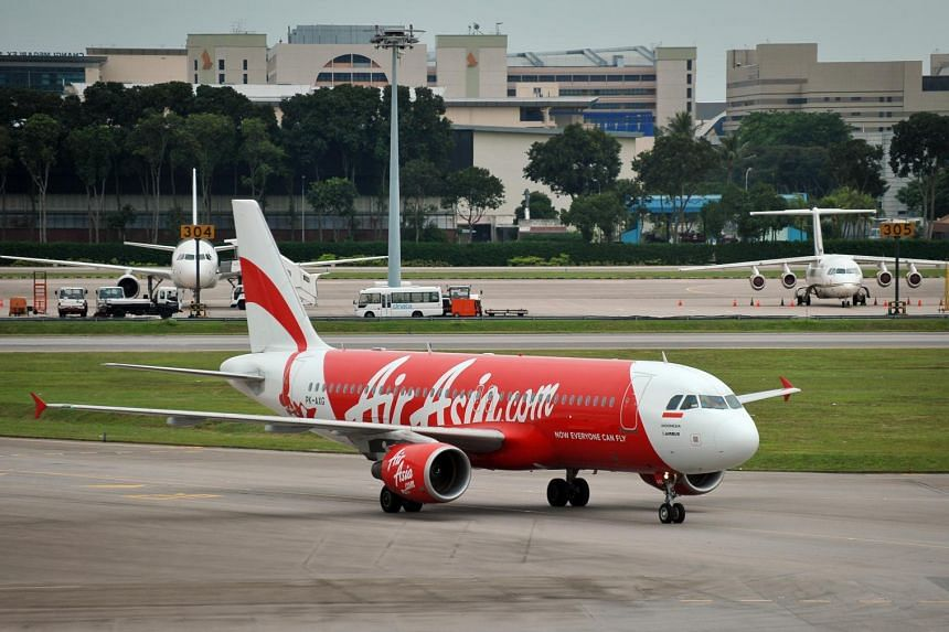 An Air Asia Airbus A320 taxiing at the Changi Airport Terminal 1.