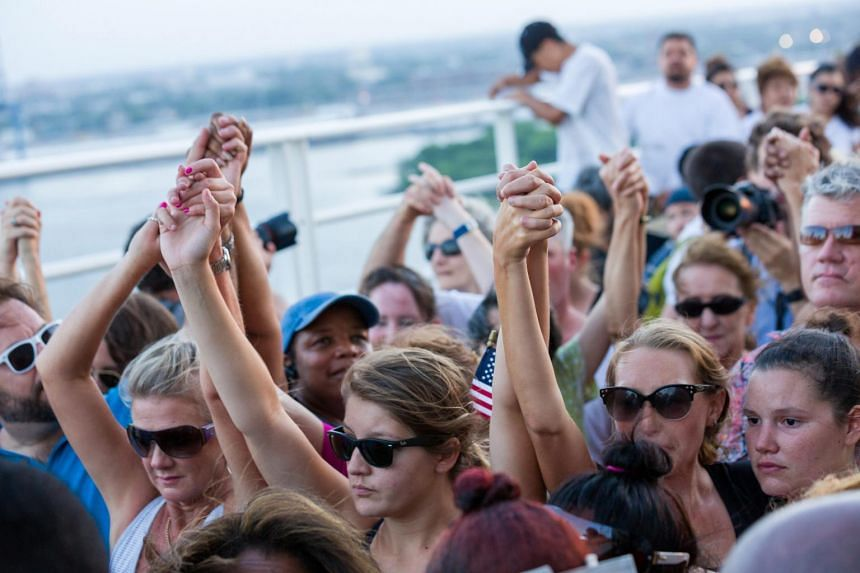 Thousands of people join hands and hold nine minutes of silence during the Unity March across the Arthur Ravenel, Jr. Bridge over the Cooper River in Charleston, South Carolina.
